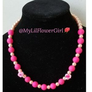 Girls pink matte and glass pearl beaded necklace.